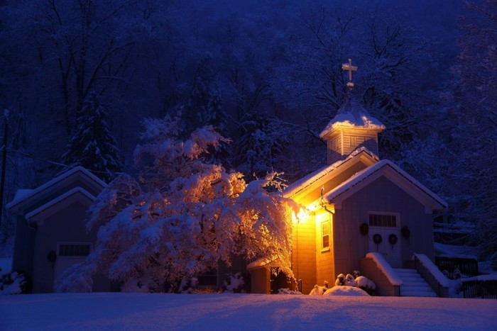 1. A small church lit up at night.
