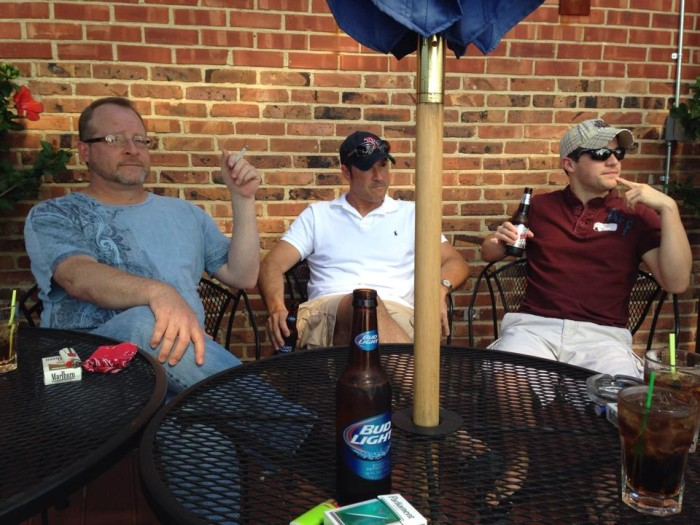 guys on patio at Club David