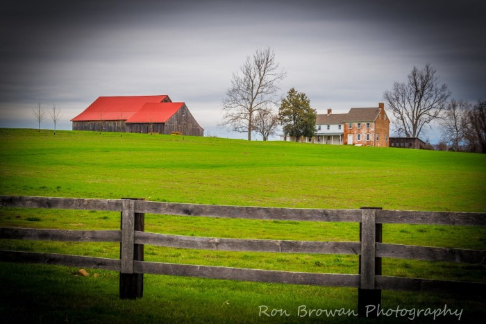 7. The bright red roof of the barn at historic Penn Farm outside of New Castle sits on the green horizon.