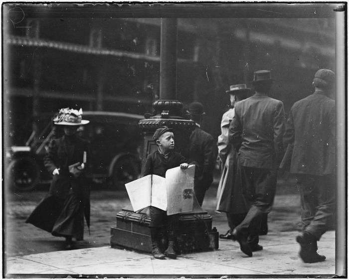 11.A small newsie downtown on a Saturday afternoon in St. Louis, May 1910.