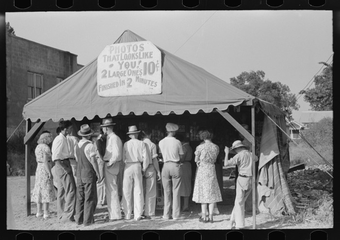 11.	A crowd in front of an itinerant photographer's tent in Steele, August 1938.