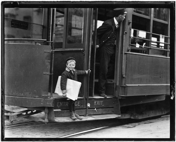 12.Little 5-year-old Francis Lance jumps on and off moving cars at risk of life. St. Louis, May 1910.