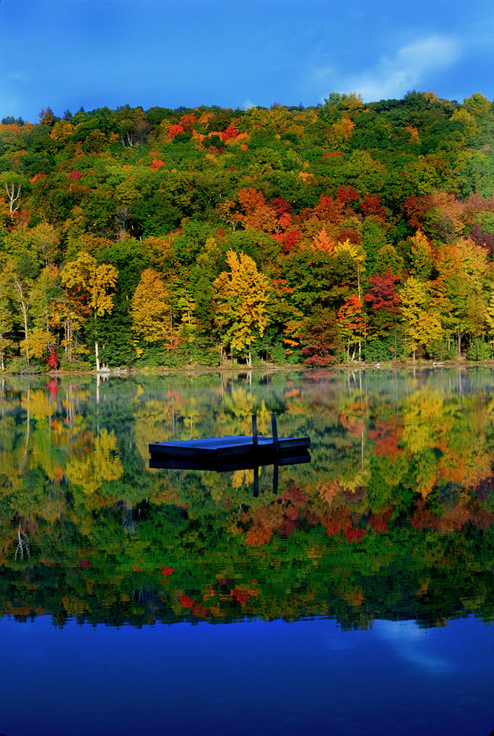 10. This quiet pond in the Berkshires reflects the gorgeous Massachusetts woodland erupting in riotous color.