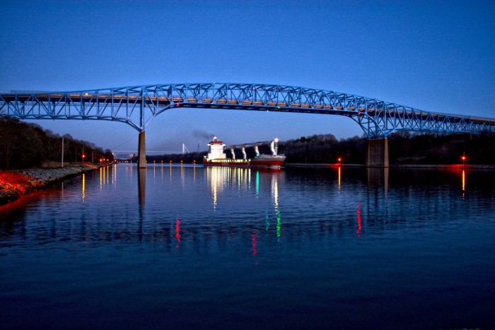 13. A ship cruising under the Reedy Point Bridge silhouetted against the night sky