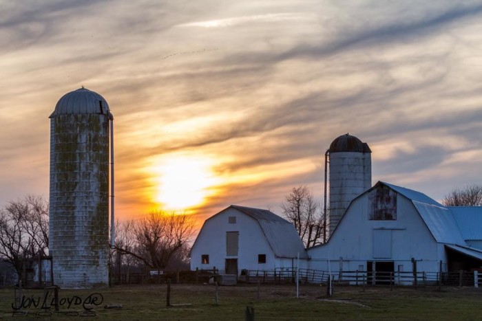 1. The sun sets above this farm west of Dover.