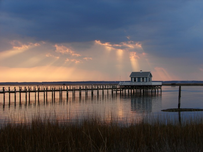 Rays of sun cast golden light over the piers