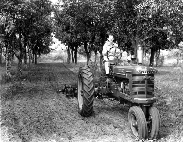 7. James H. Mills on his tractor