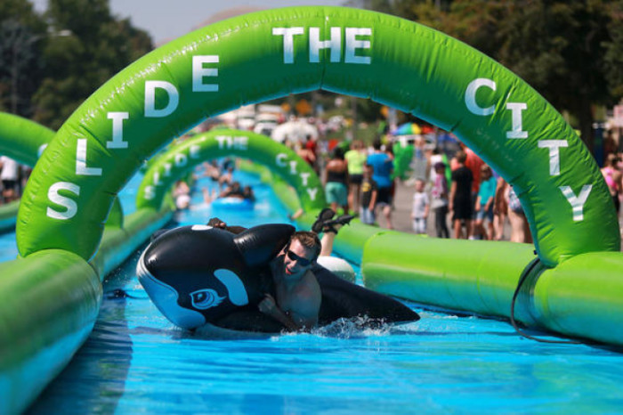3. Slip down a 1,000-foot water slide through your city.