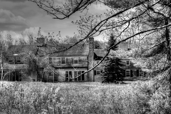 """1. Okay, this guy right here. You've got the overgrown yard, the peeling paint, the ominous sky.... Everything about this image is screaming: """"THIS IS NOT THE SUMMER HOME YOU ARE LOOKING FOR."""" Super possibly haunted. 7/10."""