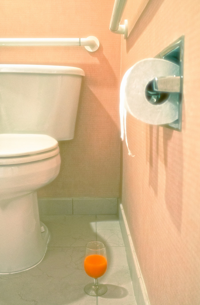 Upon entering the home, police discovered the man's girlfriend sitting on the toilet, where she had allegedly sat for the last two years.