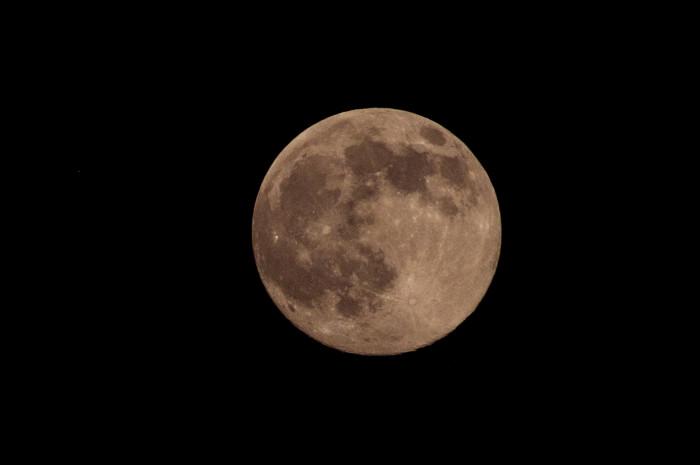 4. A summer super moon in the dark night sky