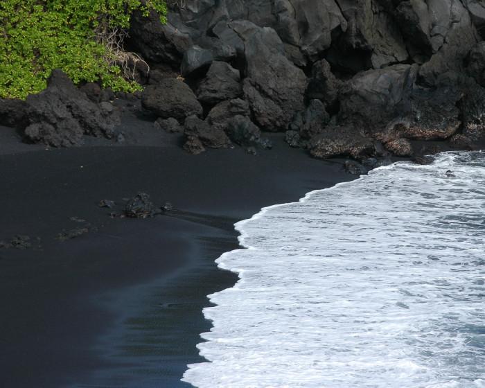 18. Visit the stunning black-sand beaches of Hawaii Island.
