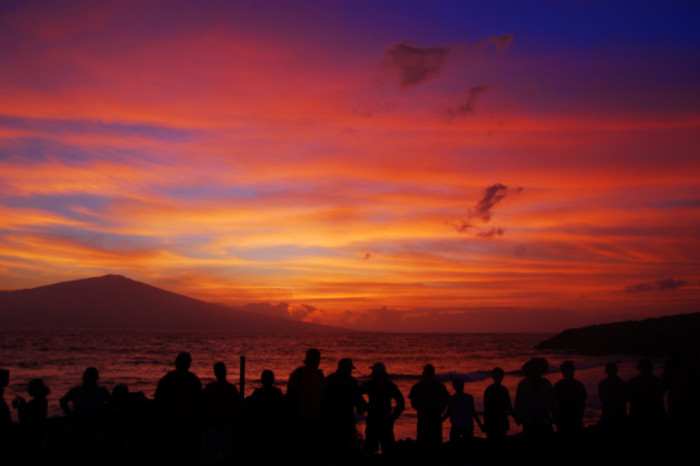 2. Head to your favorite east-side beach to watch the sunrise over the ocean.