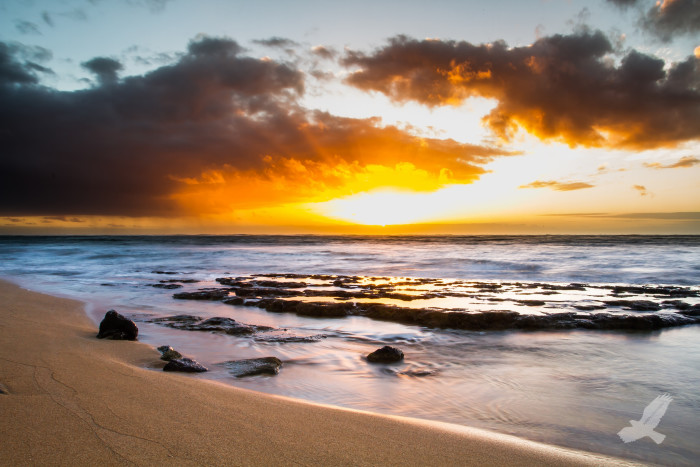 2. Wake up early to catch the sunrise over the Pacific Ocean.