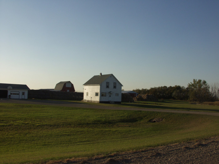 2. An older farmhouse and a classic barn peeking out from behind.
