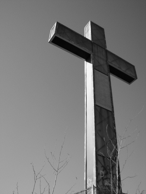 The cross atop the hill is daunting.