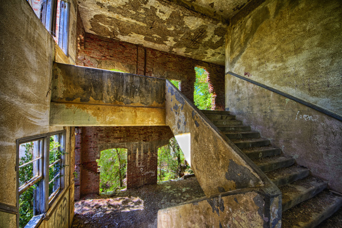 """12. """"Natural Lighting. (The Art Deco high school of Neosho Falls has long been abandoned. Once the site of Presidential visits over a century ago, now only a handful of residents remain. There remains one business - a bar.)"""