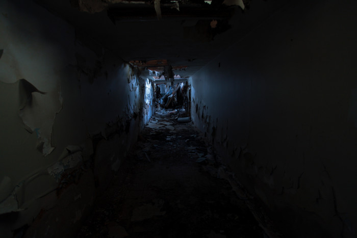Long hallways scattered with garbage lead to places unknown.