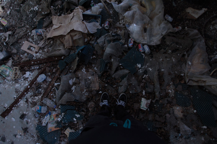 In many rooms the floors are layered with natural debris and rubbish, making it impossible to even see the floor.