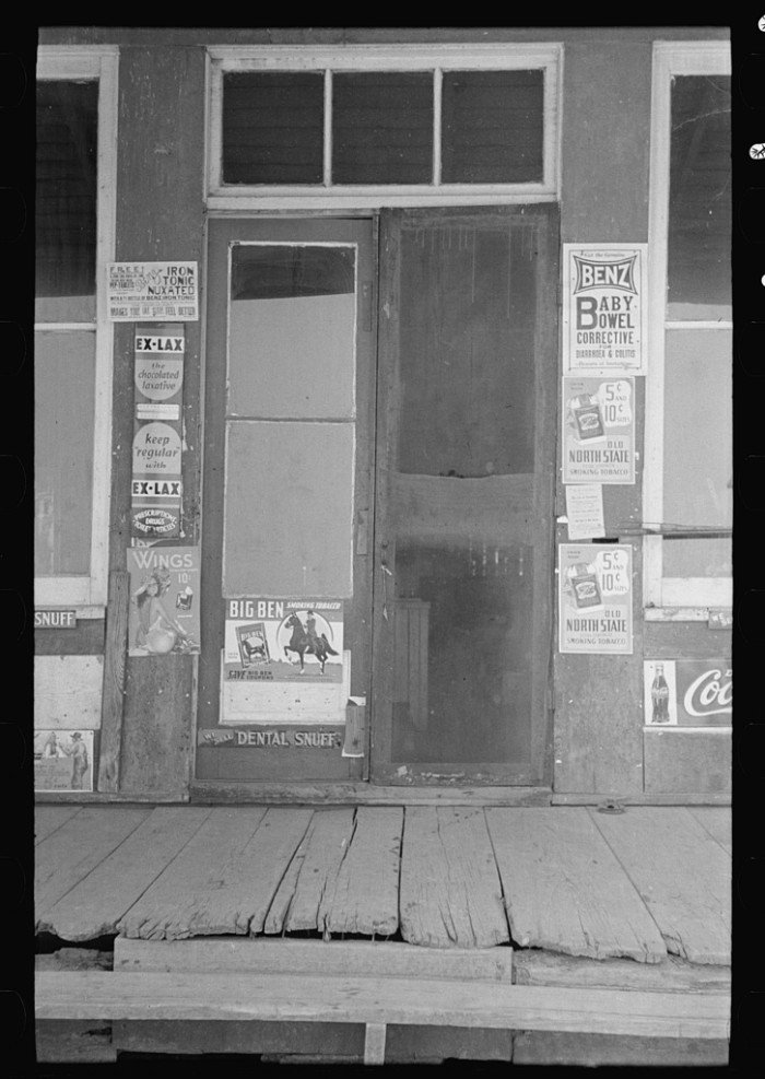 3.	The entrance to a store in La Forge, May 1938.