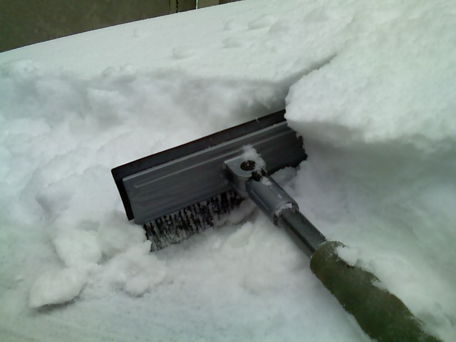 6. True romance is brushing off your partner's car on a snowy day.