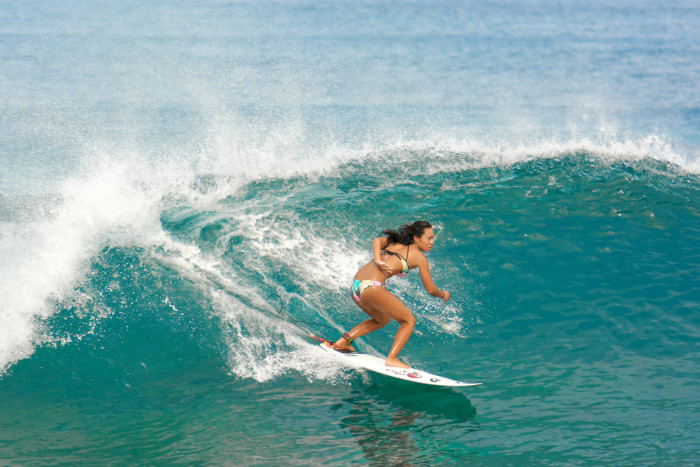 4. Learn to surf – or at least take a surfing lesson.