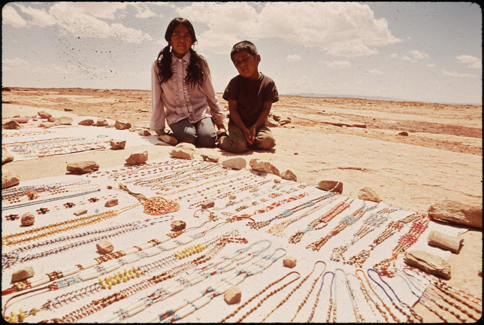 9. These two kids helped their parents sell some lovely jewelry on the roadside.