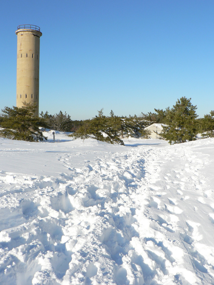 8. The tower at Cape Henlopen stands tall above the snow covered dunes.
