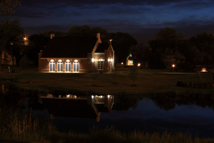 5. A lit up chapel reflected over a pond in this late night photograph.