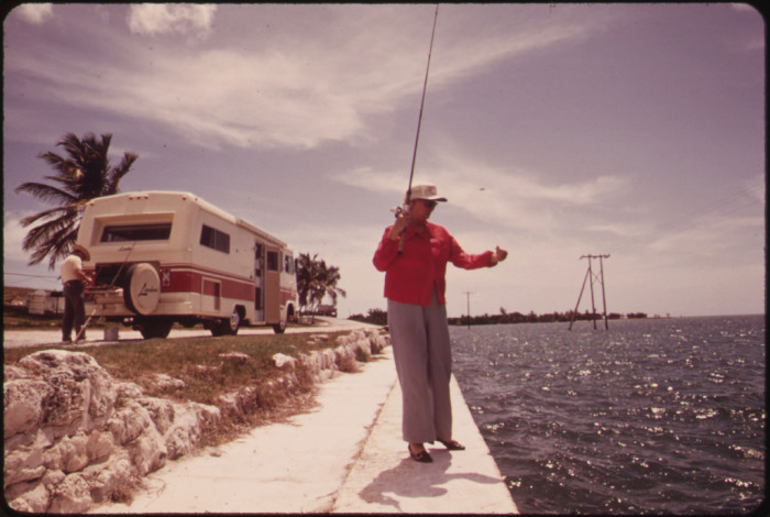 25. A Retired Couple From California Stop to Fish Off Embankment at Spanish Harbor Key. Travel-Trailers of the Kind Owned by This Couple Are Highly Popular Among Visitors to the Keys.