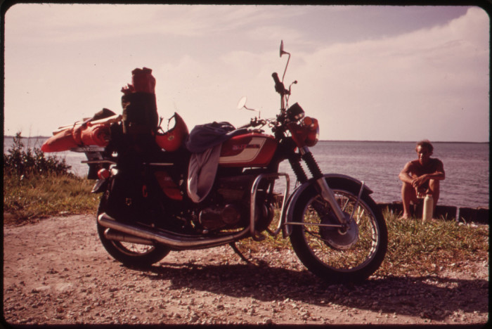 17. Vacationer From Ohio Relaxes near His Motorcycle During Sightseeing Tour of the Keys.