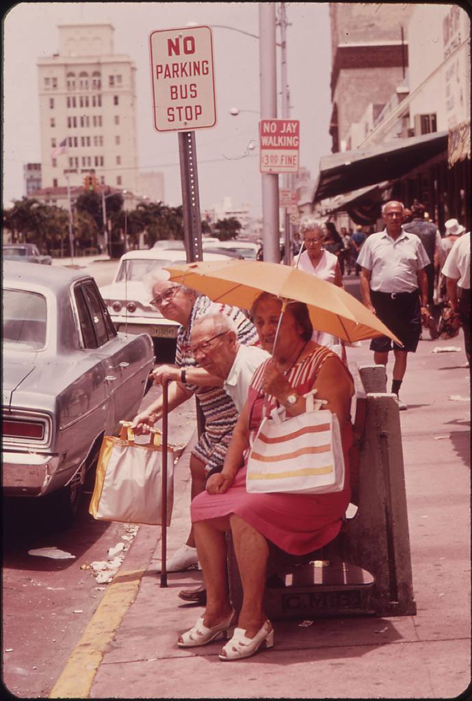 18. The South Beach Area of Miami Beach Has Attracted a Growing Colony of People of Retirement Age. This Group Waits for a Bus after a Shopping Trip.