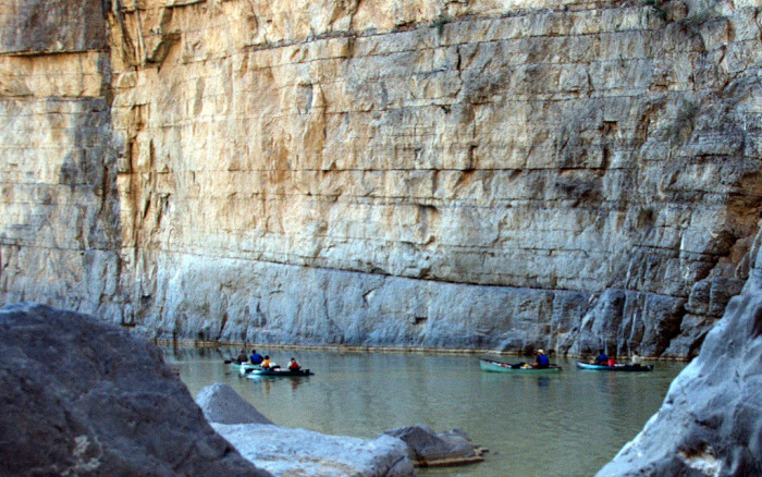 Paddlers float down the Rio Grande in the Santa Elena Canyon