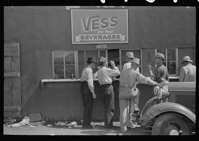 5.	Farmers at auction drinking soft drinks, Sikeston, May 1938.