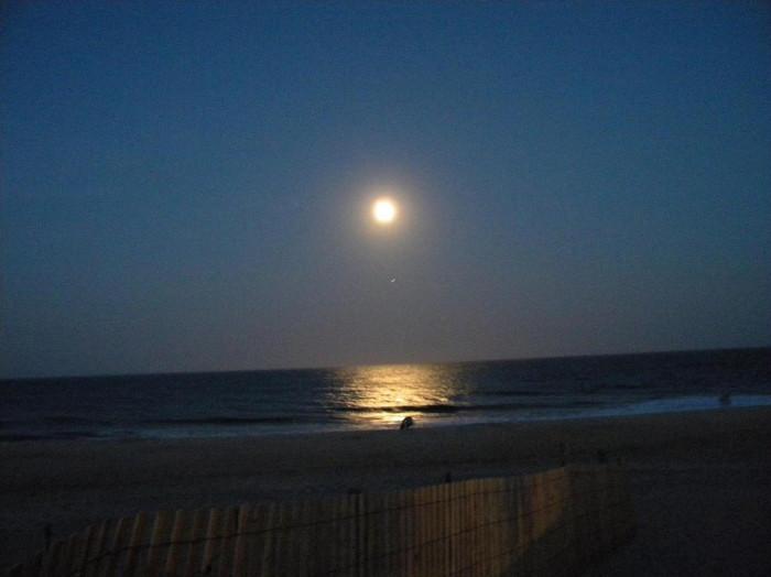 14. A full moon over the Atlantic Ocean