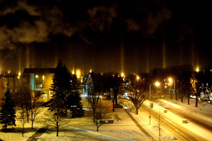 9. Due to cold winter temperatures, light is diffused by frozen crystals to form these pillars of light - taken in Grand Forks.