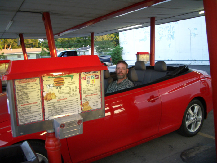 11. Who wouldn't love an old fashioned burger? It's ordered, served, and eaten the good ol' fashioned way - Drive-in style!