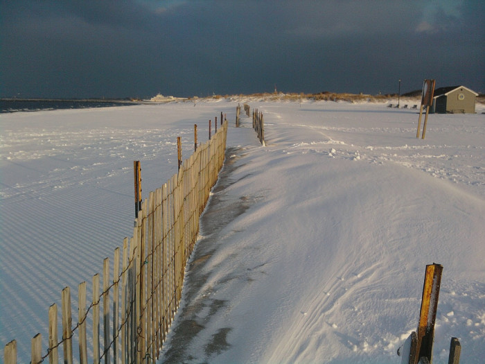 10. White snow blankets the sand at Lewes Beach.
