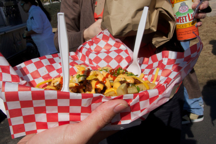 7. Kimchi fries from Chilantro BBQ - A Mexican/Korean fusion food truck, turned brick and mortar establishment. Today, you can visit the many food trucks and restaurants where Chilantro serves up supremely fiery bites of flavor, day and night.
