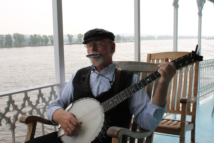 Musician, singer and songwriter L.A. Suess of Galena, Illinois, is one of the performers on the Riverboat Twilight. During Suess's performance, he sings, plays the harmonica, banjo, guitar and mandolin, giving guests a unique and unforgettable show.