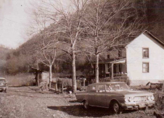 15. This is a picture of a farmhouse and car taken in 1963.