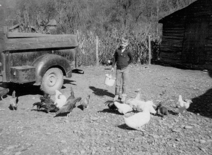 12. This one of a boy feeding chickens was taken in 1963.