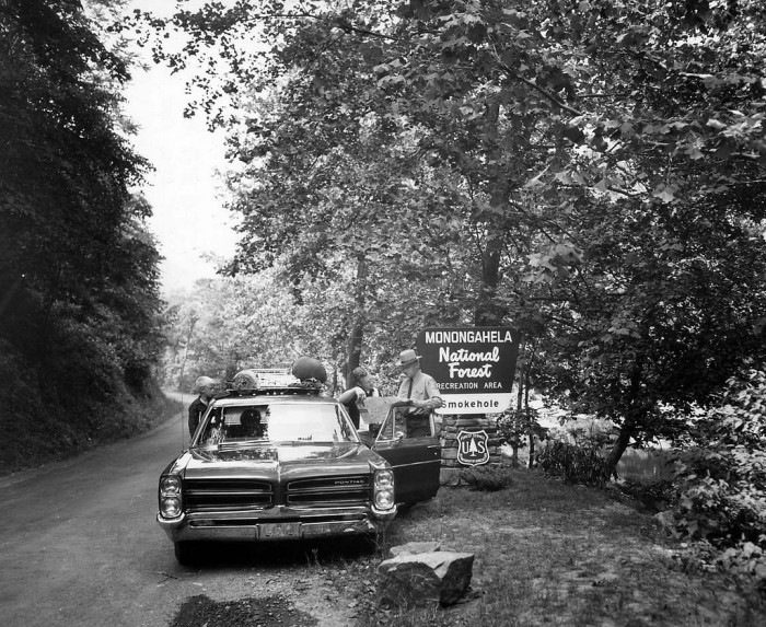 9. Ranger Joe Tekel gives directions to a family at the Smokehole Recreation Area, Monongahela National Forest, West Virginia in 1966.