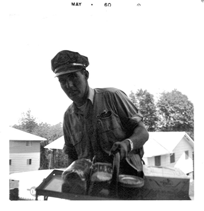 7. This milkman delivers milk and bread in Garden Farms, Huntington, West Virginia. May 1960.