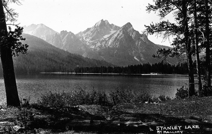 7. Stanley Lake in 1920 looks peaceful and majestic with the mountains rising in the background.