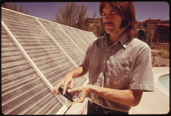 4. Noted by the photographer as a solar energy researcher and expert, this man shows off a solar passive method of heating water. In this case, it was used for his swimming pool in Tucson.