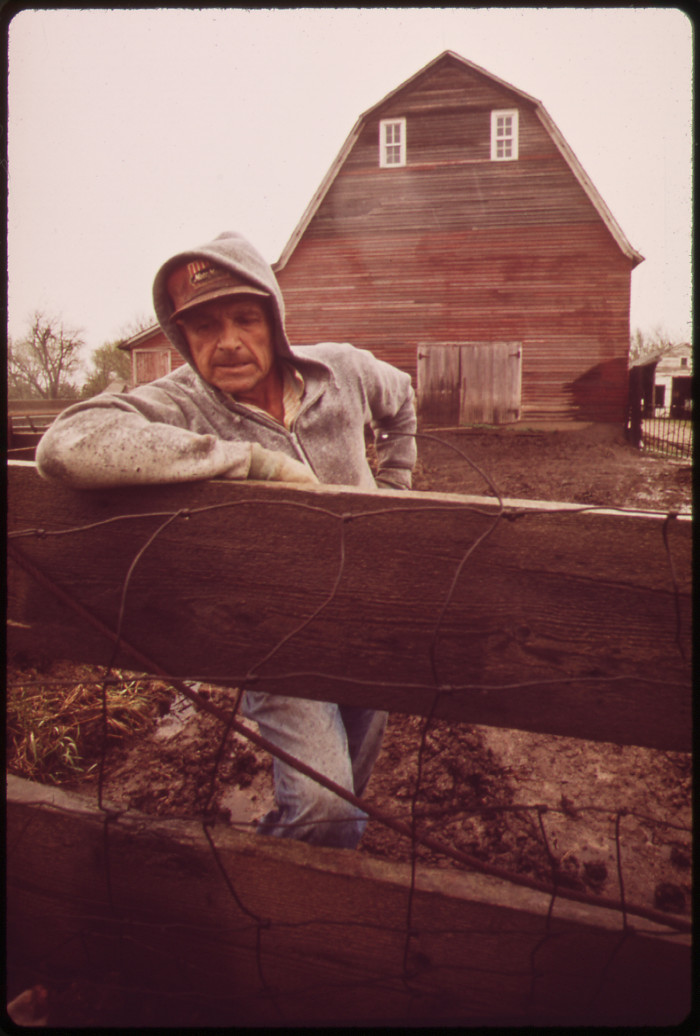 7. John Dolezal, a farmer near Bee, looks tough and determined while standing in the rain.