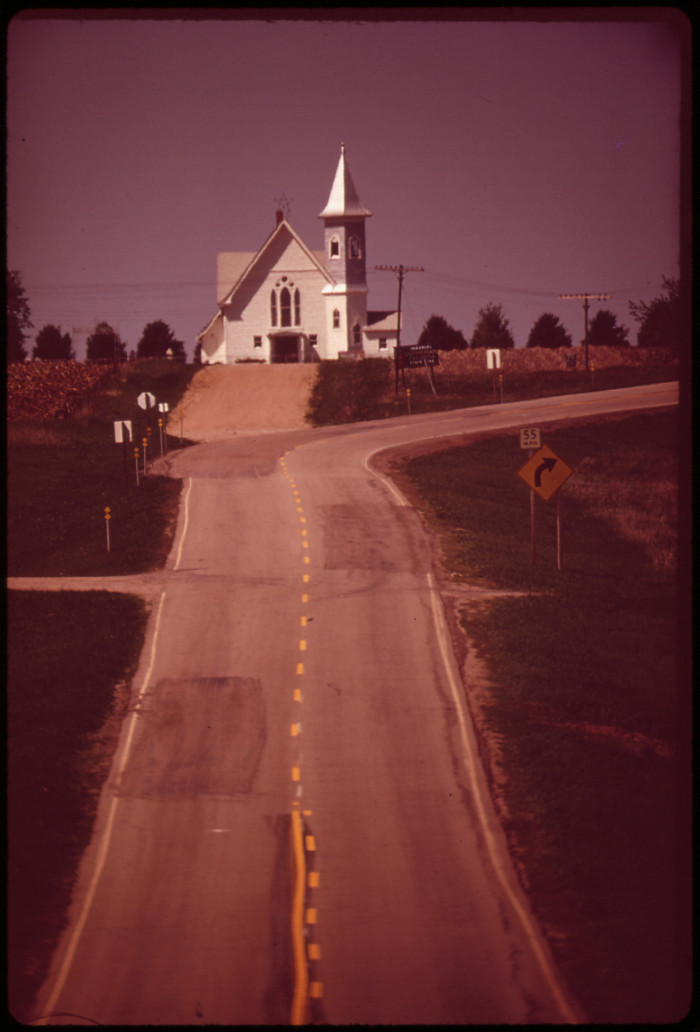 """14. From the original caption: """"The Immanuel Lutheran Church marks the state line between Kansas and Nebraska, May 1973."""""""