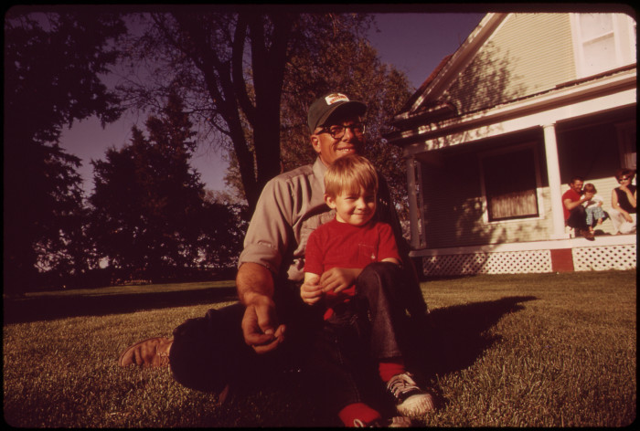 16. Farmer Frank Otte sits on the lawn with his grandson, Troy, while the rest of the family watches on. Mr. Otte was actually born on this farm. May 1973.