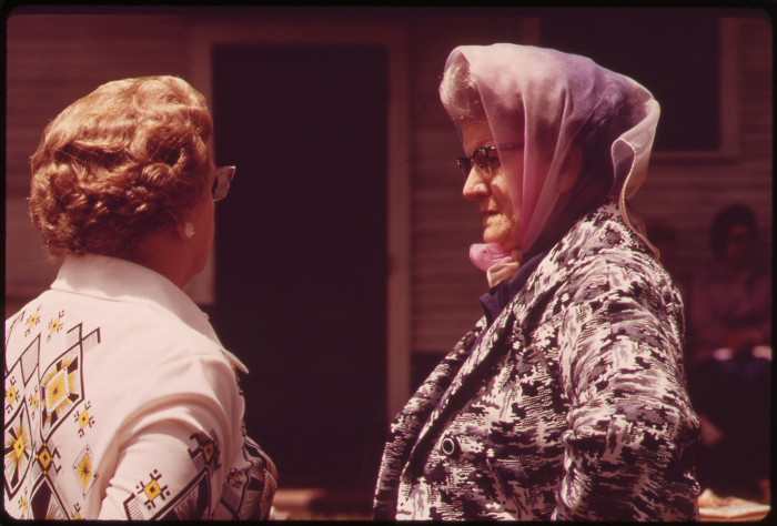 17. A pair of older ladies pause at an auction in Fairbury to chat for a few moments, May 1973.